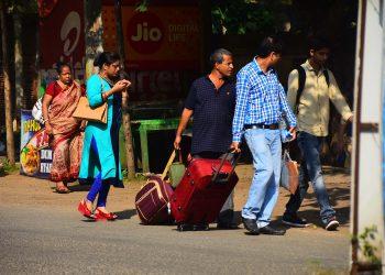 Tourists walk to reach their destinations