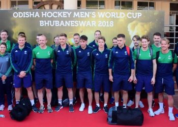 The Irish players and officials pose for a photograph after their arrival at the city airport, Sunday