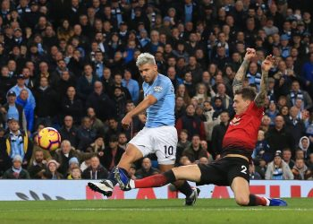 Sergio Aguero (10) strikes the ball past a sliding Man United defender straight into the opposition net (not in picture) at Etihad Stadium, Sunday