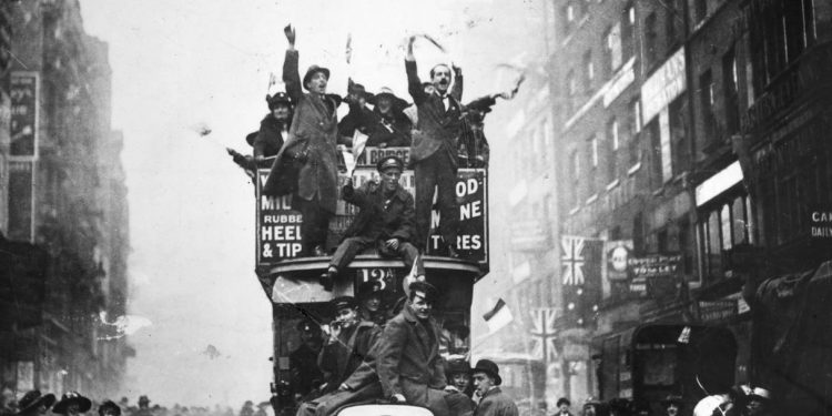 Crowds in London celebrate the end of hostilities in 1918