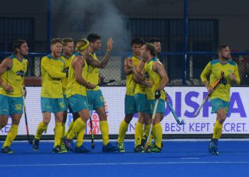 Australia players celebrate after scoring against Ireland, Friday