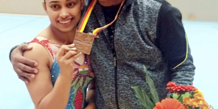 Indian gymnast Dipa Karmakar poses with her coach Bisweswar Nandi after wining bronze in Vault event at Artistic Gymnastic World Cup in Cottbus, Germany, Saturday