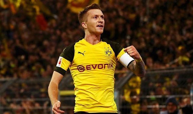 Marco Reus wheels away in celebration after scoring against Bayern Munich in Dortmund, Saturday