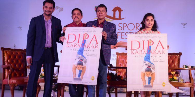 (From L) Senior journalists Digvijay Singh Deo, Vimal Mohar, coach Bishweshwar Nandi and gymnast Dipa Karmakar unveil the cover of the book 'Dipa Karmakar: The Small Wonder' at Ekamra Sports Literary Festival in Bhubaneswar, Saturday