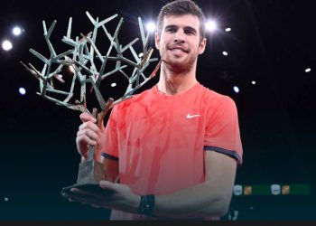 Karen Khachanov poses with the winner's trophy after defeating Novak Djokovic in the final in Paris, Sunday