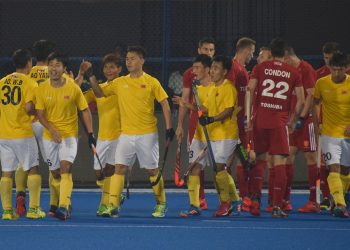 China players (in yellow) celebrate one of their goals against England at the Kalinga Stadium, Friday