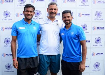 Amit Rohidas, Birendra Lakra and Harendra Singh pose for photographs after the media interaction in Bhubaneswar, Saturday
