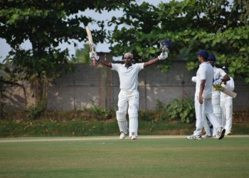 Biplab Samantray raises his bat after completing century against Haryana in Bhubaneswar, Sunday