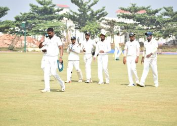 Basant Mohanty leads Odisha team to the pavilion after getting the six-wicket haul against UP at KIIT Stadium in Bhubaneswar, Wednesday