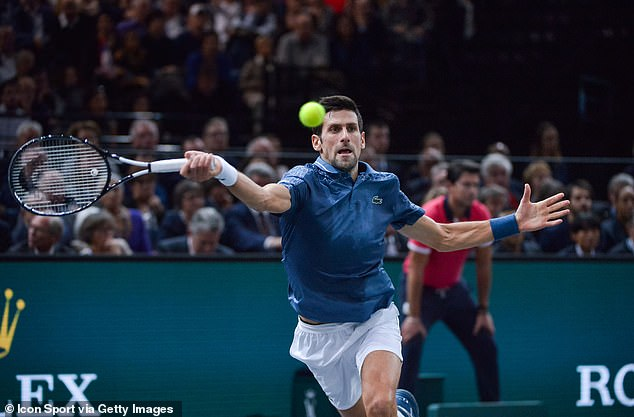 Novak Djokovic stretches to play a shot against Roger Federer in Paris, Saturday