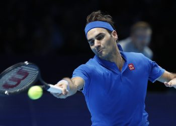 Roger Federer plays a return to Dominic Thiem during their ATP World Tour Finals men's singles match at the O2 arena in London, Tuesday