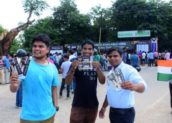 Fans show their tickets in front of a crowdie Gate No.9 of the Kalinga Stadium in Bhubaneswar, Monday