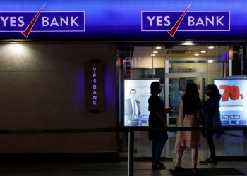 Employees enter a Yes Bank branch at its headquarters in Mumbai, January 17, 2018. REUTERS