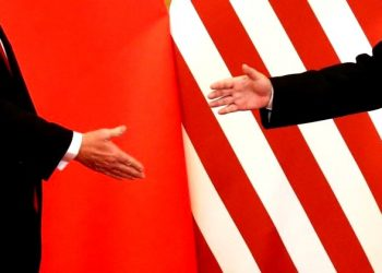 FILE PHOTO - U.S. President Donald Trump and China's President Xi Jinping shake hands after making joint statements at the Great Hall of the People in Beijing, China, November 9, 2017. (REUTERS)