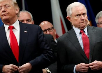 U.S. President Donald Trump and Attorney General Jeff Sessions button their coats as they stand for the national anthem at a graduation ceremony at the FBI Academy on the grounds of Marine Corps Base Quantico in Quantico, Virginia, U.S. December 15, 2017. REUTERS/Jonathan Ernst/File Photo