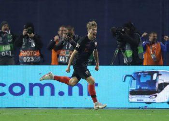Tin Jedvaj wheels away in celebration after scoring the late winner against Spain in Zagreb, Thursday