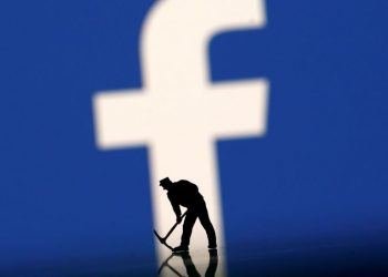 FILE PHOTO: Figurines are seen in front of the Facebook logo in this illustration taken March 20, 2018. (REUTERS)