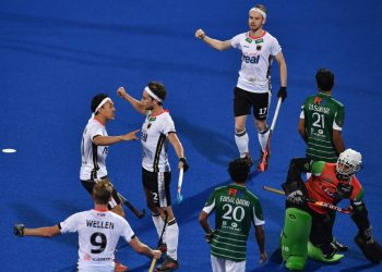 Germany players (in white) celebrate after scoring the winners against Pakistan at Kalinga Stadium, Saturday