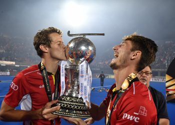 Belgian players celebrate with the hockey World Cup Sunday