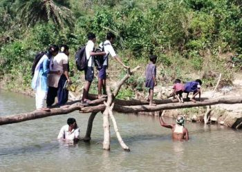 Determined for education, students cross river dangerously to reach school