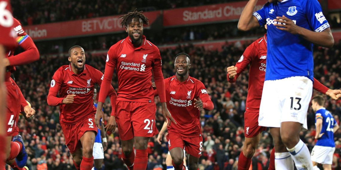 Divock Origi (C) leads Liverpool's celebration after scoring last gasp winner as Everton's Yerry Mina (blue-white) looks dejected at Anfield, Sunday