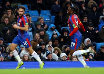 Andros Townsend (L) wheels away in celebration after scoring the winner for Crystal Palace against Man City, Saturday