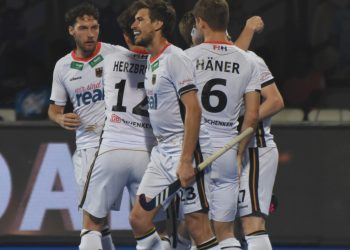 Germany players celebrate one of their goals against Malaysia at the Kalinga Stadium, Sunday