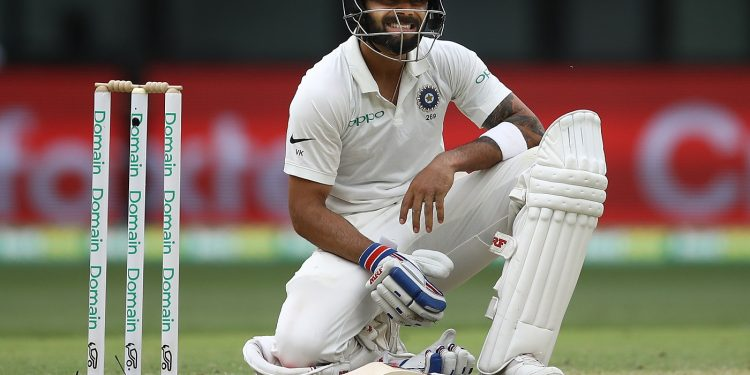 Virat Kohli reacts after diving to make his ground during day two of the second match against Australia at Perth Stadium