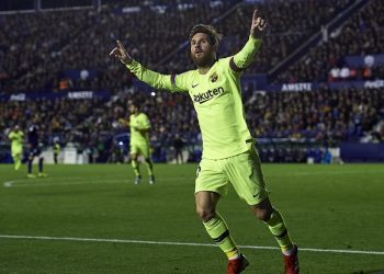 Lionel Messi wheels away in celebration after scoring against Levante, Sunday