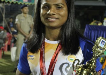 Dutee Chand poses with her medals and best women's athlete trophy in Cuttack, Sunday