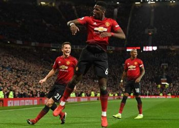 Manchester United's Paul Pogba (C) leaps high in celebration after scoring one of his two goals against Bournemouth while teammates Ander Herrera (L) and Ashley Young join in at Old Trafford Sunday