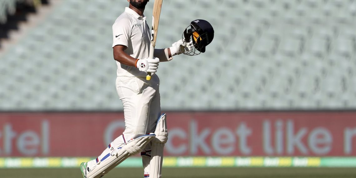 Cheteshwar Pujara celebrates after reaching a century against Australia in Adelaide