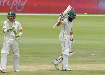 Hashim Amla raises his bat after reaching fifty while Dean Elgar applauds against Pakistan in Centurion, Friday
