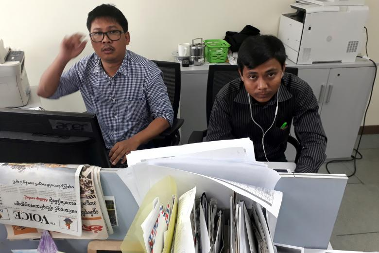Reuters journalists Wa Lone (L) and Kyaw Soe Oo pose for a picture at the Reuters office in Yangon, Myanmar December 11, 2017. REUTERS