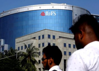 People walk past a building of IL&FS (Infrastructure Leasing and Financial Services Ltd.) outside its headquarters in Mumbai, India, September 25, 2018. REUTERS