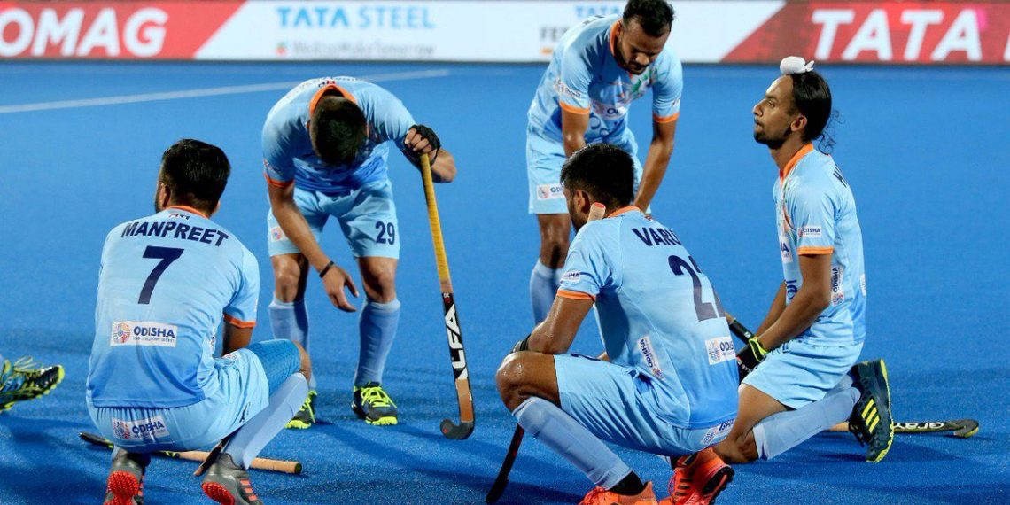 Indian players wear a dejected look after losing their quarterfinal match against the Netherlands in the Men's Hockey World Cup in Bhubaneswar