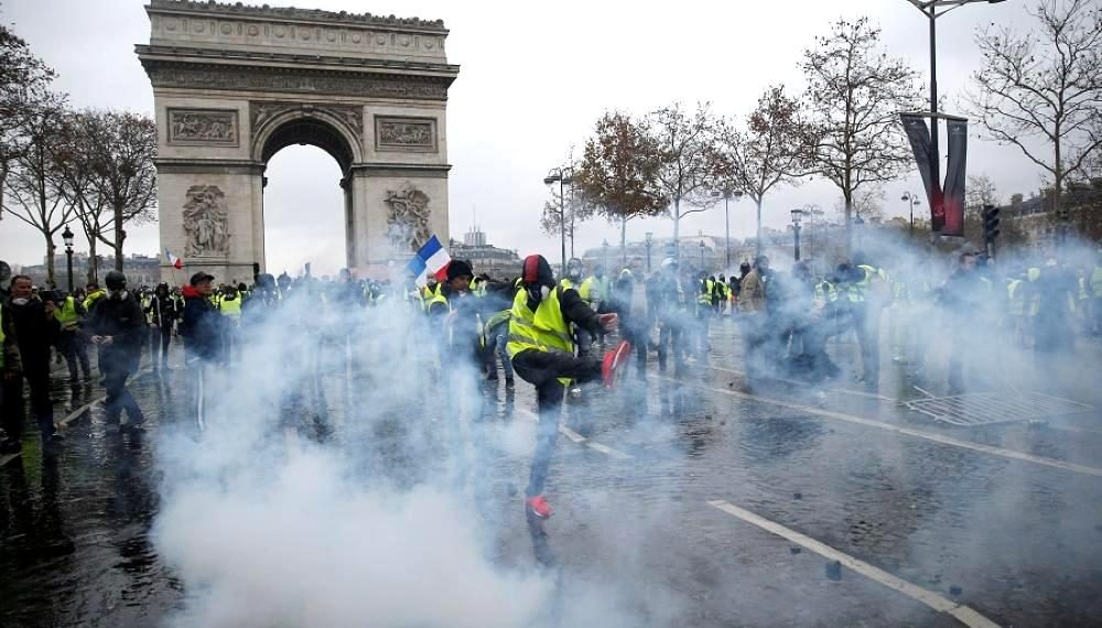 , Macron visits riot-damaged Arc de Triomphe, state of emergency mulled