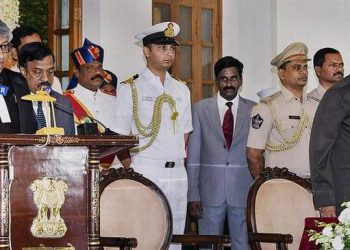 Governor of A.P. and Telangana E.S.L. Narasimhan administering the oath of office to Justice Thottathil Bhaskaran Nair Radhakrishnan