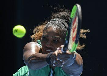 United States' Serena Williams makes a backhand return to Karolina Pliskova of the Czech Republic during their quarterfinal match at the Australian Open tennis championships in Melbourne, Australia, Wednesday, Jan. 23, 2019. (AP)