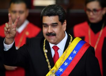 Venezuela's President Nicolas Maduro flashes the victory sign after being sworn-in at the start of a second six-year term (AP)