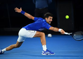 Novak Djokovic reaches for a shot during his match against Daniil Medvedev (not in pic) in Melbourne, Monday