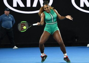 Serena Williams plays a return during her Australian Open match against Simona Halep (not in pic) in Melbourne, Monday