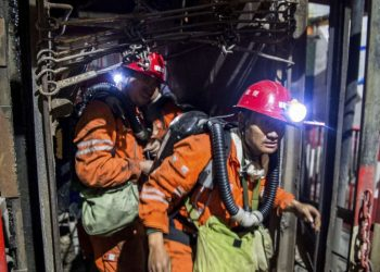 Rescue workers at the site of the mining accident, Saturday at Shaanxi province in China
