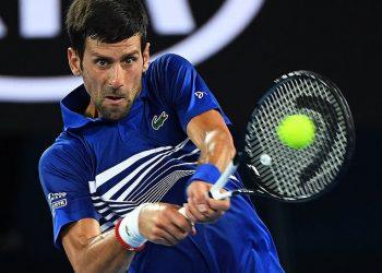 Novak Djokovic plays a shot against Jo-Wilfried Tsonga in Melbourne, Thursday