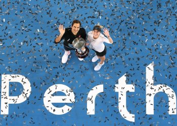 In an ariel view Roger Federer (L) and Belinda Bencic pose for the shutterbugs with the winner's trophy at Perth Saturday