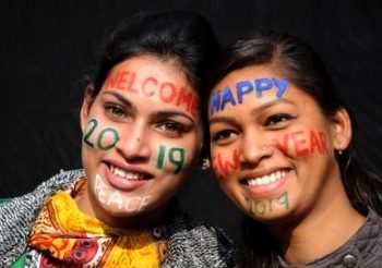 Godspeed 2018 and welcome 2019. People with face paints in Amritsar, on Dec 31, 2018. (IANS)