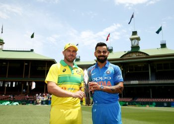 Indian skipper Virat Kohli (R) and his Australian counterpart Aaron Finch pose with the ODI trophy at the SCG, Friday