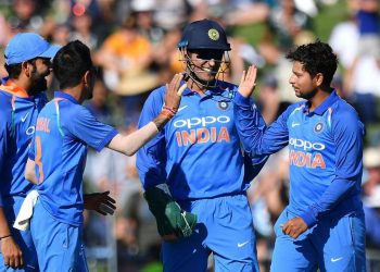 Kuldeep Yadav (R) celebrates after picking up a wicket, Wednesday