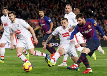Lionel Messi (right) shoots to score his 400th La Liga goal during the match against Eibar, Sunday