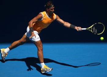 MELBOURNE, AUSTRALIA - JANUARY 14:  Rafael Nadal of Spain plays a forehand in his first round match against James Duckworth of Australia during day one of the 2019 Australian Open at Melbourne Park on January 14, 2019 in Melbourne, Australia.  (Photo by Julian Finney/Getty Images)